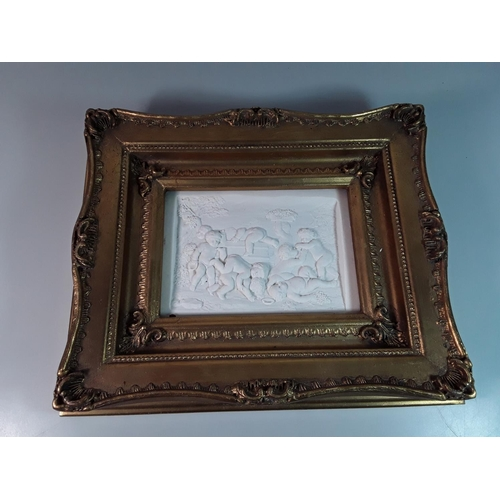 40 - Gilt framed marble plaque depicting cherubs, overall size approx 12'' x 10''...