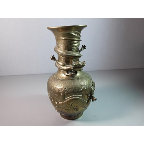 43 - Oriental bronze vase with 3D dragon detail, approx 10'' tall...