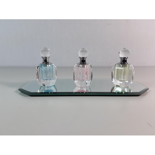 1 - Set of three bottles on glass tray...
