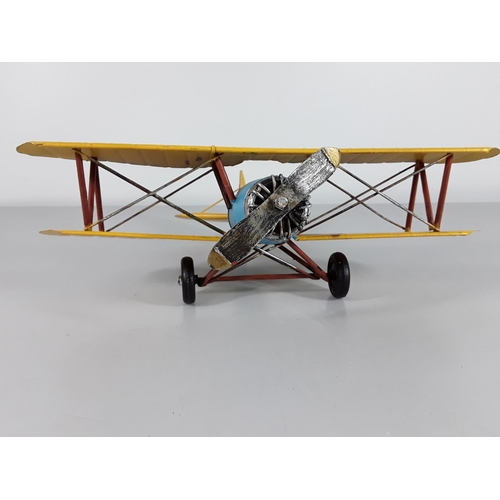 12 - Tin plate model of a Bi-plane...