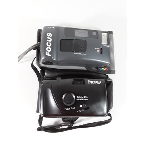 54 - 2 Cased cameras...