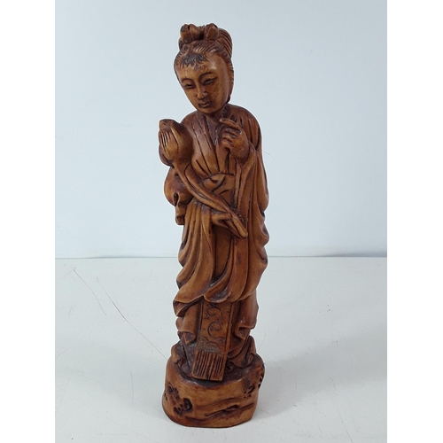 33 - Carved wood oriental figure approx 30cms...