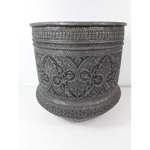 59 - Large metal eastern decorated planter approx 33cms diameter and 36cms tall...