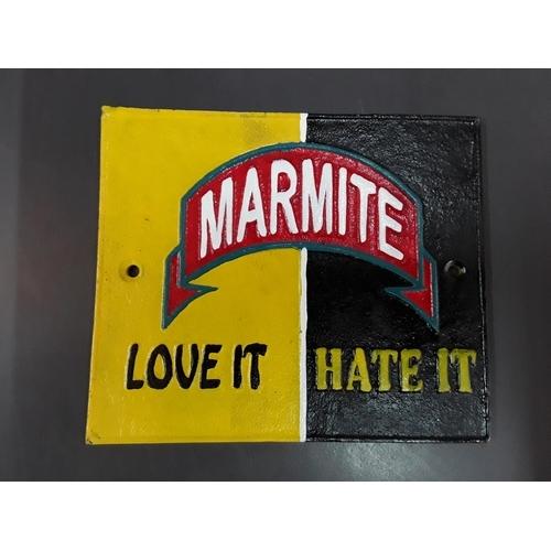 1 - Cast iron Marmite sign...
