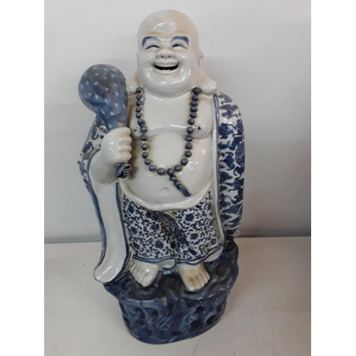 5 - Large blue and white porcelain figure of a Buddha approx 43cms tall...