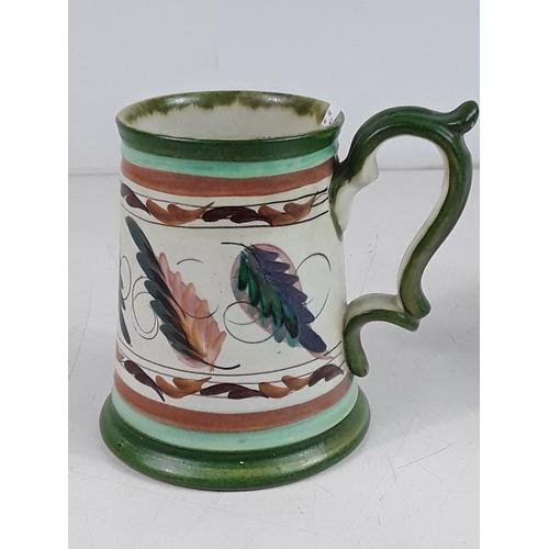 52 - Signed art pottery tankard...