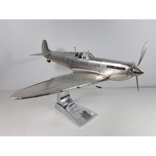 57 - Large AM (authentic models) Spitfire on stand with signed plaque approx 60cms by 77cms by 38cms...