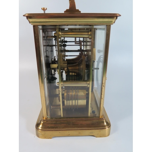 175 - A Goliath Brass Cased Repeating Carriage Clock with twin fusee chain driven movement, the silvered d...