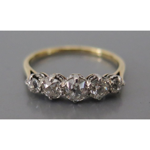 229 - An 18ct Gold and Diamond Five Stone Ring, size M.5, 2.2g...
