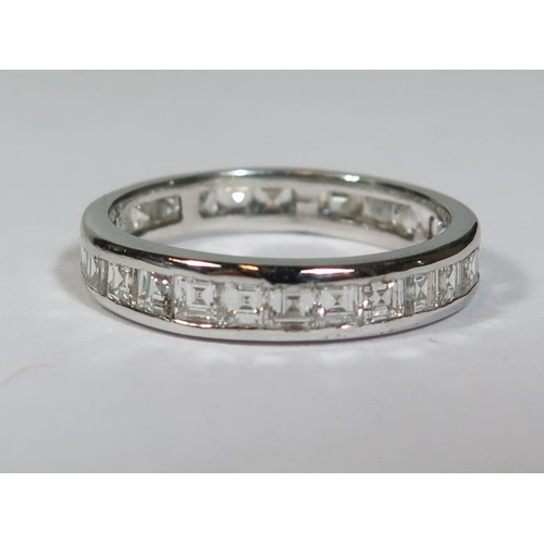 229a - A Diamond Eternity Ring in 18ct white gold setting, size R, 3.9g...