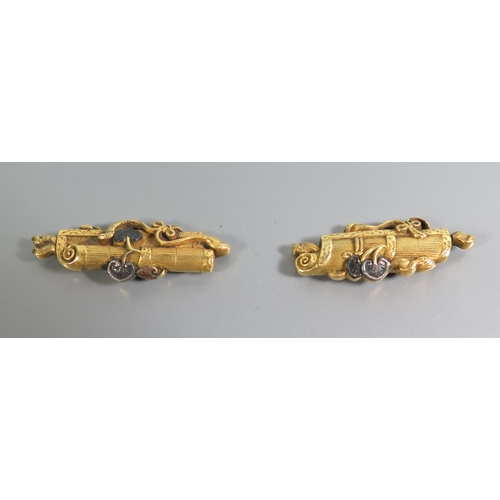 260 - A Pair of Nineteenth Japanese Gold Costume Decorations, 39 & 37 mm long, 5.4 and 5g, in fitted box...