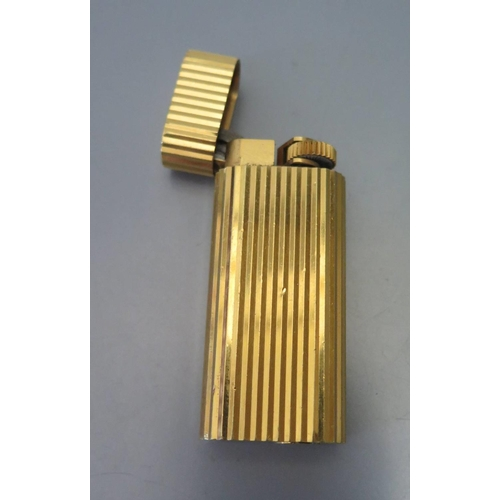 27a - A Cartier Gold Plated Lighter, 1989, A45483...