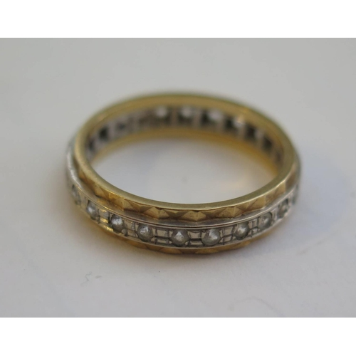 50c - An 18ct White and Yellow Gold Diamond Eternity Ring, size M.5, 4g...