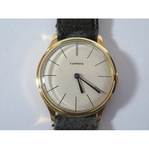 168 - A Jaeger LeCoultre 18ct Gold Gent's Wristwatch with Cartier 34mm dial, movement no. 1203369, 1960's,...