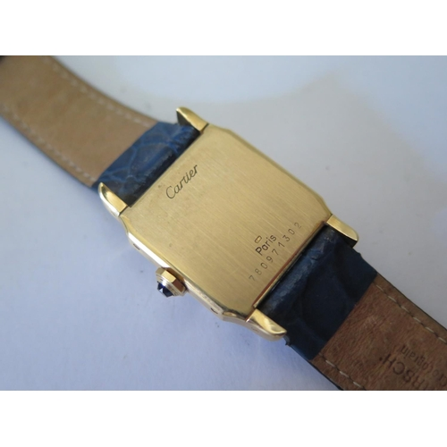 232 - A Cartier Santos Ladies 18ct Gold Wristwatch, the 17mm dial with Roman numerals and manual movement,...