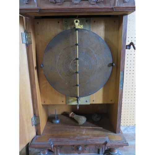 270 - An Oak Symphonion Hall Clock style 25ST, dating from c. 1895. The machine plays 11 3/4