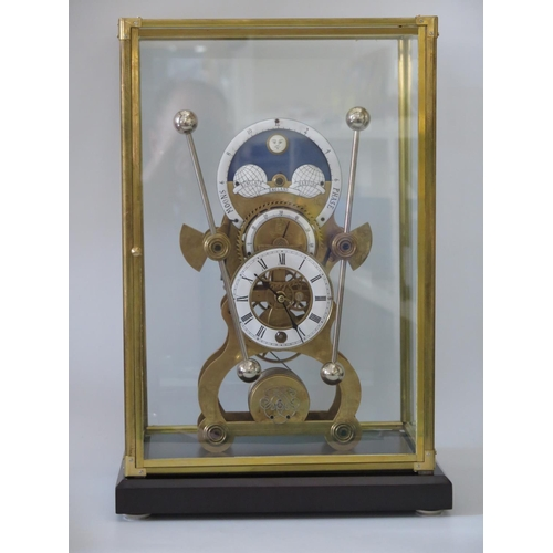 272 - A Moon Phase Clock beneath glass case, overall height 48cm...