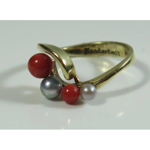 308 - A Pearl and Coral Ring, size O, 3.9g...