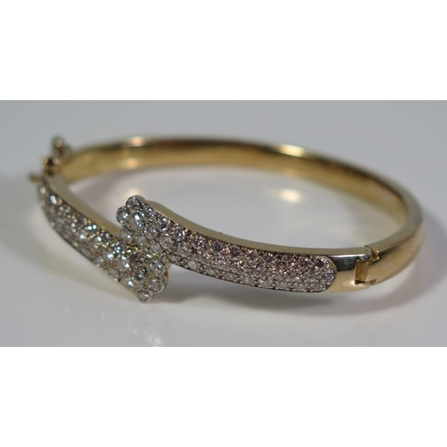 319 - A Diamond and Gold Hinged Bangle, 20g. EDW 2.28ct...
