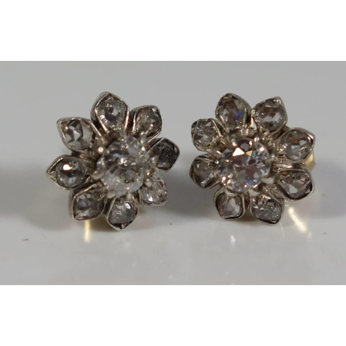 321 - A Pair of Diamond Floral Cluster Studs, 3.7g...