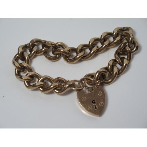330 - A Heavy 9ct Gold Curb Link Bracelet with heart clasp, 56.5g...