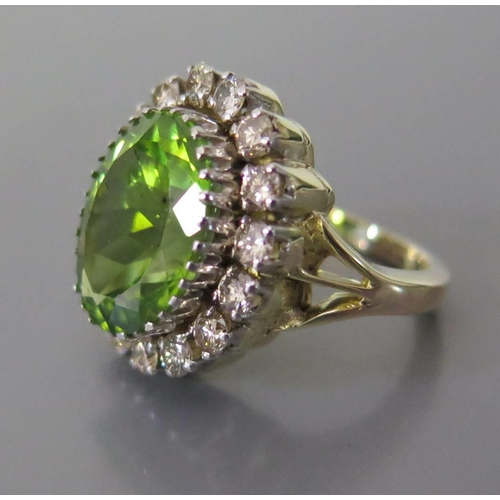 358 - A Peridot and Diamond Cluster Ring in a 14K yellow gold setting, size L, 7.9g. Peridot 7.7ct EDW 1ct...