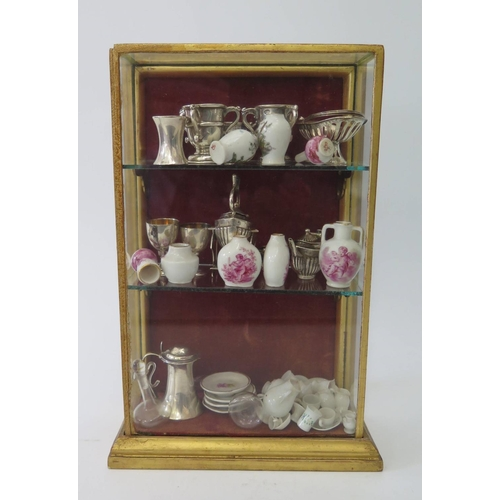 462 - A Collection of Doll's House Miniature Silver, Porcelain and Glass. Including Edwrad VII four part s...