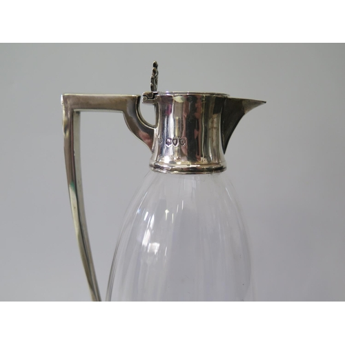 463 - A Victorian Silver Mounted Claret Jug, London 1895, W. Hutton & Sons, 24.5cm high...