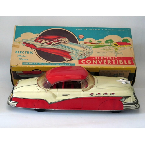 497 - Tin Plate Toy _ A Marx Electric Motor Driven Convertible. Manufactured in 1955 and complete with ori...