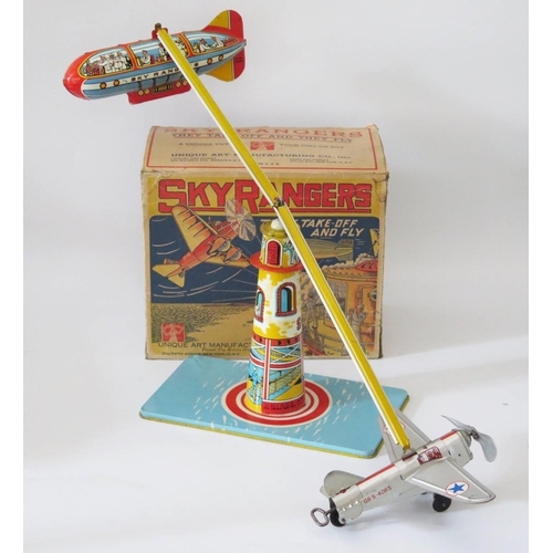 502 - Tin Plate Toy _ Unique Art Manufacturing Co. 'Sky Rangers They Taker Off and Fly'. 1st Version manuf...