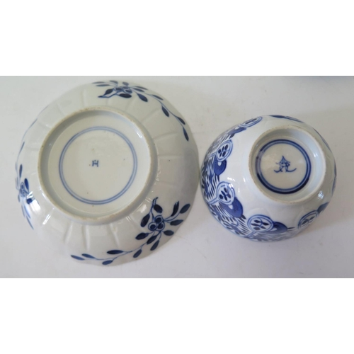 516 - A Pair of Chinese Porcelain Blue and White Tea Bowls with saucers...
