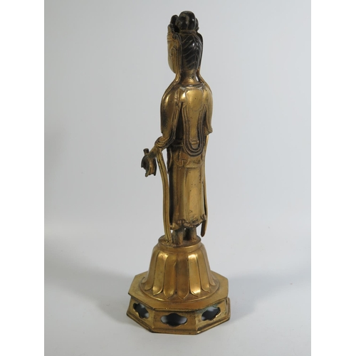 518 - A Chinese Gilt Bronze Figure of Buddha standing on a lotus flower, 30cm...