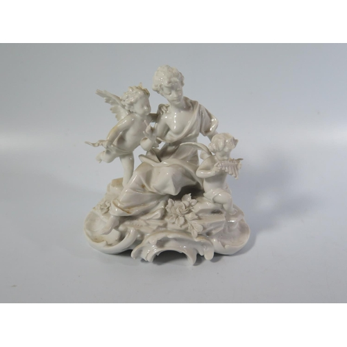 591 - A Capodimonte Blanc de Chine Figural Group of seated lady with putti, 12cm high...