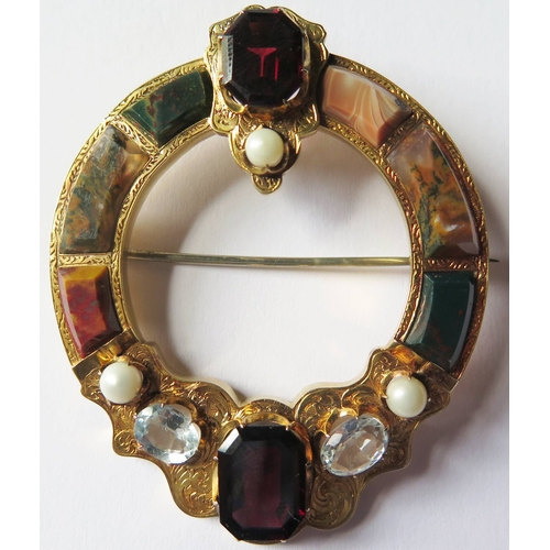 314 - A Fine Scottish Hardstone and Jewelled Brooch with pendant loop in a high carat gold setting, 17.23g...