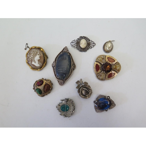 129 - A Victorian Shell Cameo Brooch, two others and Miracle brooches...