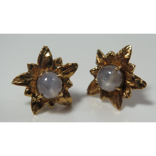 132 - A Pair of Star Sapphire Earrings in a high carat gold setting, 7g...