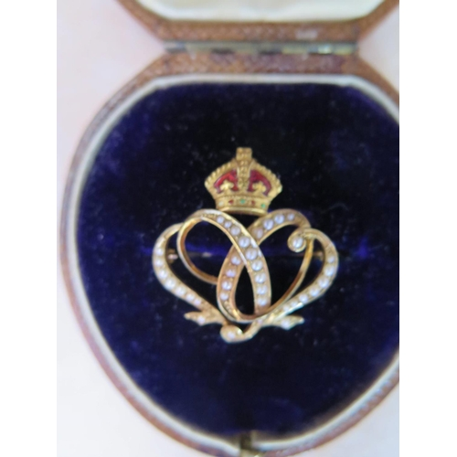 137 - An Elkington Boxed Precious Yellow Metal, Seep Pearl and Enamel Brooch with crown finial, 3.7g...