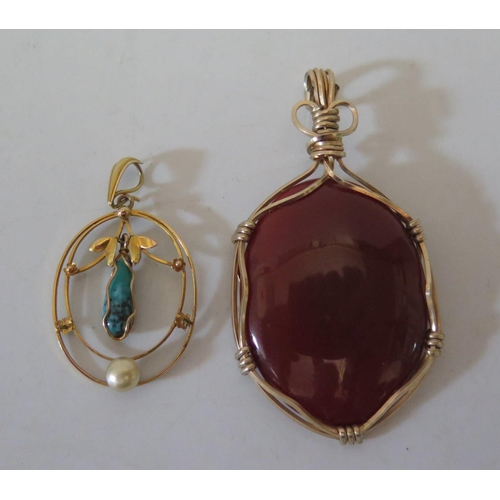 180 - A 9ct Gold Turquoise and Pearl Pendant 2.1g and one costume pendant...