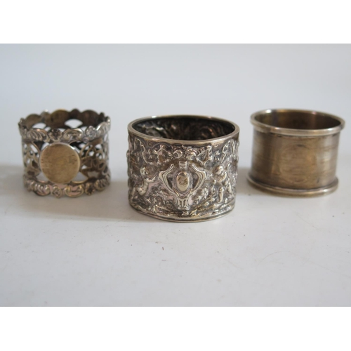 20 - A Victorian Silver Napkin Ring decorated with putti and ribbons in a continuous landscape Birmingham...