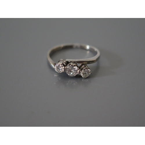 200c - A Diamond Three Stone Cross Over Ring in a precious white metal mount, size L, 2.5g, EDW .4ct...