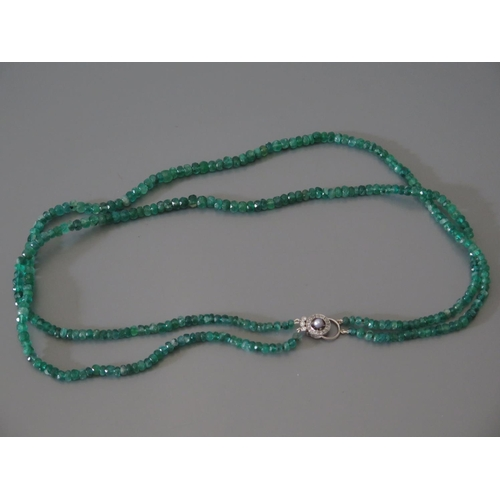 208 - A Faceted Bead Emerald Necklace with a pearl and diamond clasp...