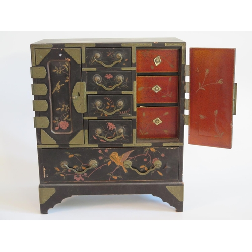 279 - A Japanese Lacquered Kodansu with foliate decoration...