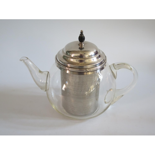 11 - A Pyrex Teapot with silver plated mounts...