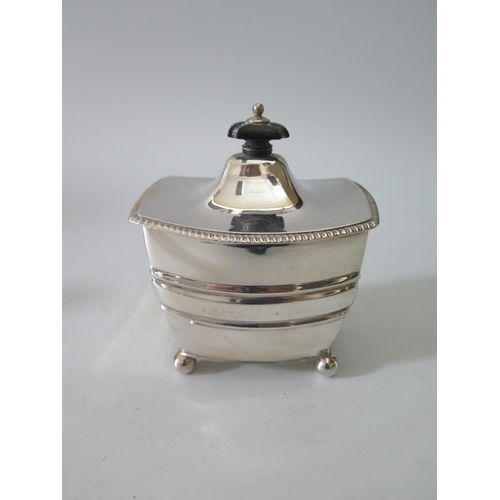 115a - A Victorian Silver Tea Caddy with ebony finial and raised on four ball feet, Sheffield 1897, Henry S...