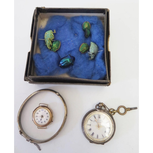 125 - A Damaged 9ct Gold Ladies Watch, silver cased pocket watch, silver bangle and insect specimens...