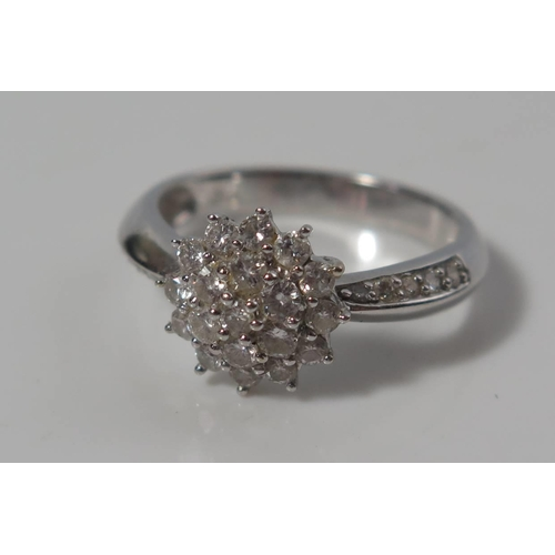 168 - A Diamond Cluster Ring in .750 stamped white gold setting, size M, 4.1g...
