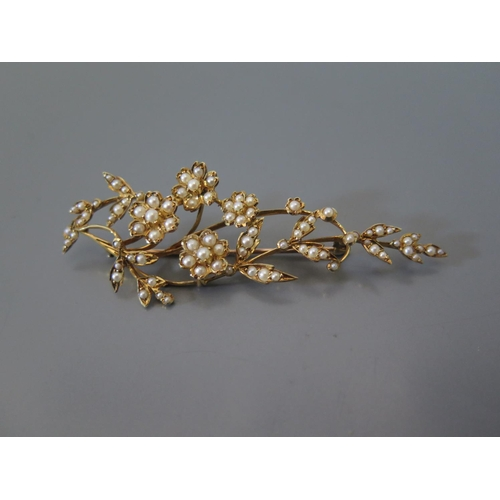 188 - A Seed Pearl Floral Spray Brooch in a precious yellow metal setting, 9.3g, 7cm...