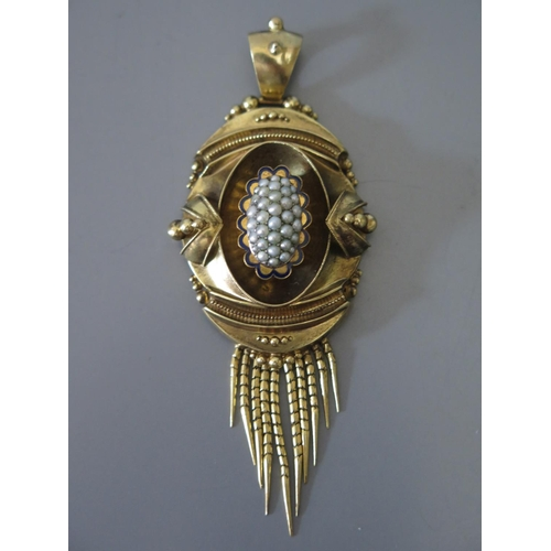 203 - A Victorian Gold Pendant with blue enamel and pearl decoration and photograph of gentleman to the ba...