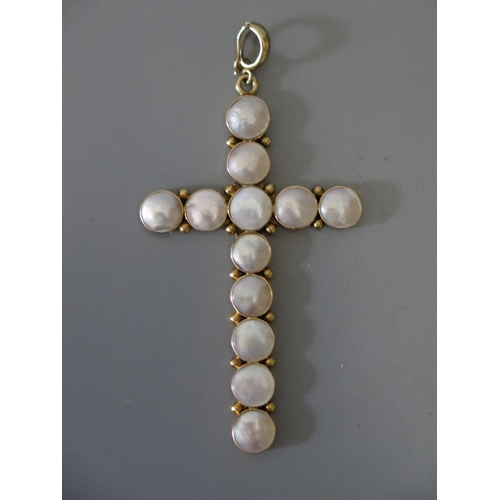 209 - A Blister Pearl Cross Pendant in a precious yellow metal setting, 8.8g...