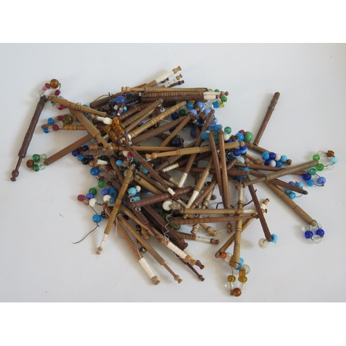 254 - A Large Collection of Nineteenth Century Turned Wooden Lace Maker's Bobbins with glass spangles...